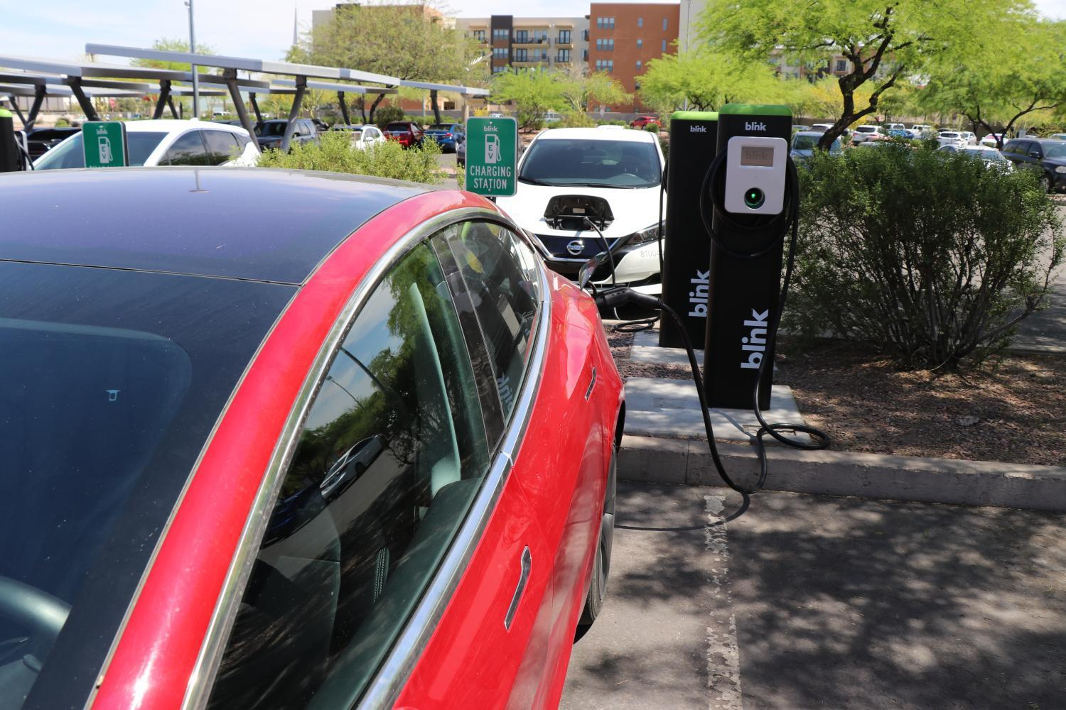 car using electric charging station