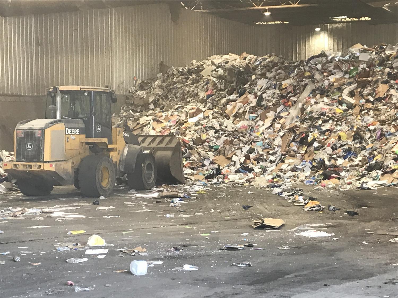bulldozer compacting garbage landfill waste