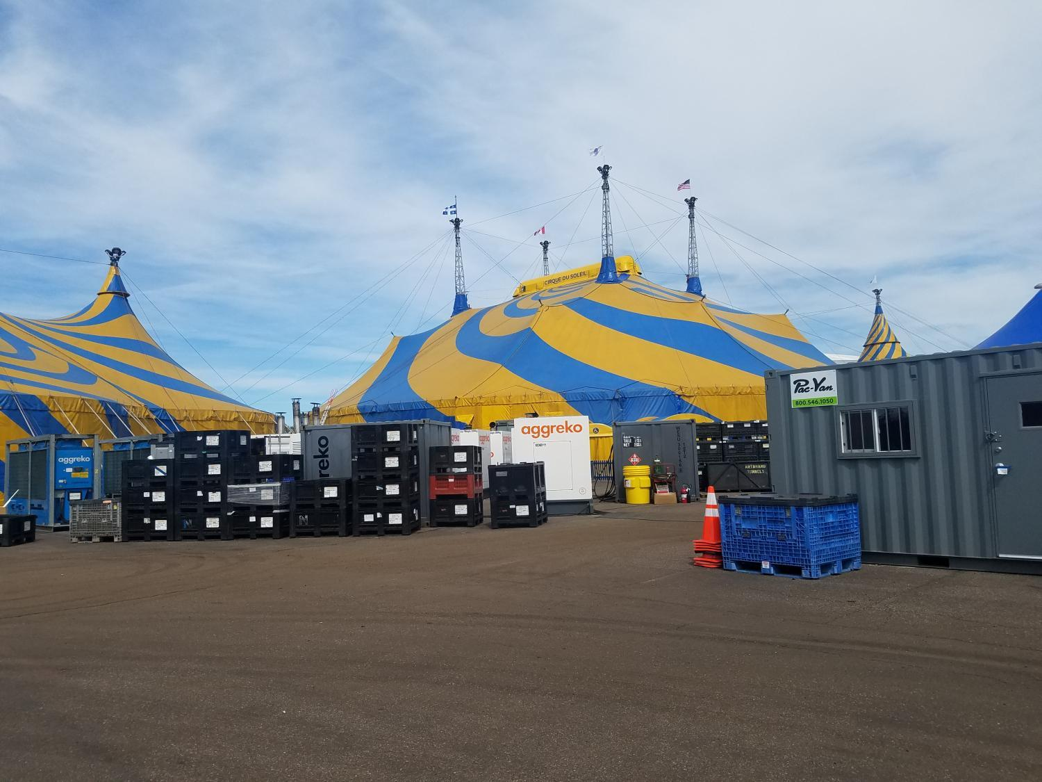 The show happens under a giant blue and yellow tent, which is set up in each new city.