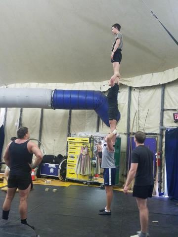 Performers practice for the show by standing on each other