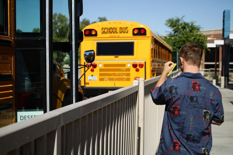 Conor Mills walks to a school bus