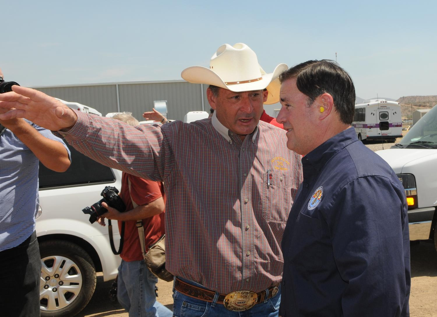 Gov. Doug Ducey (right) talks with Rep. David Cook