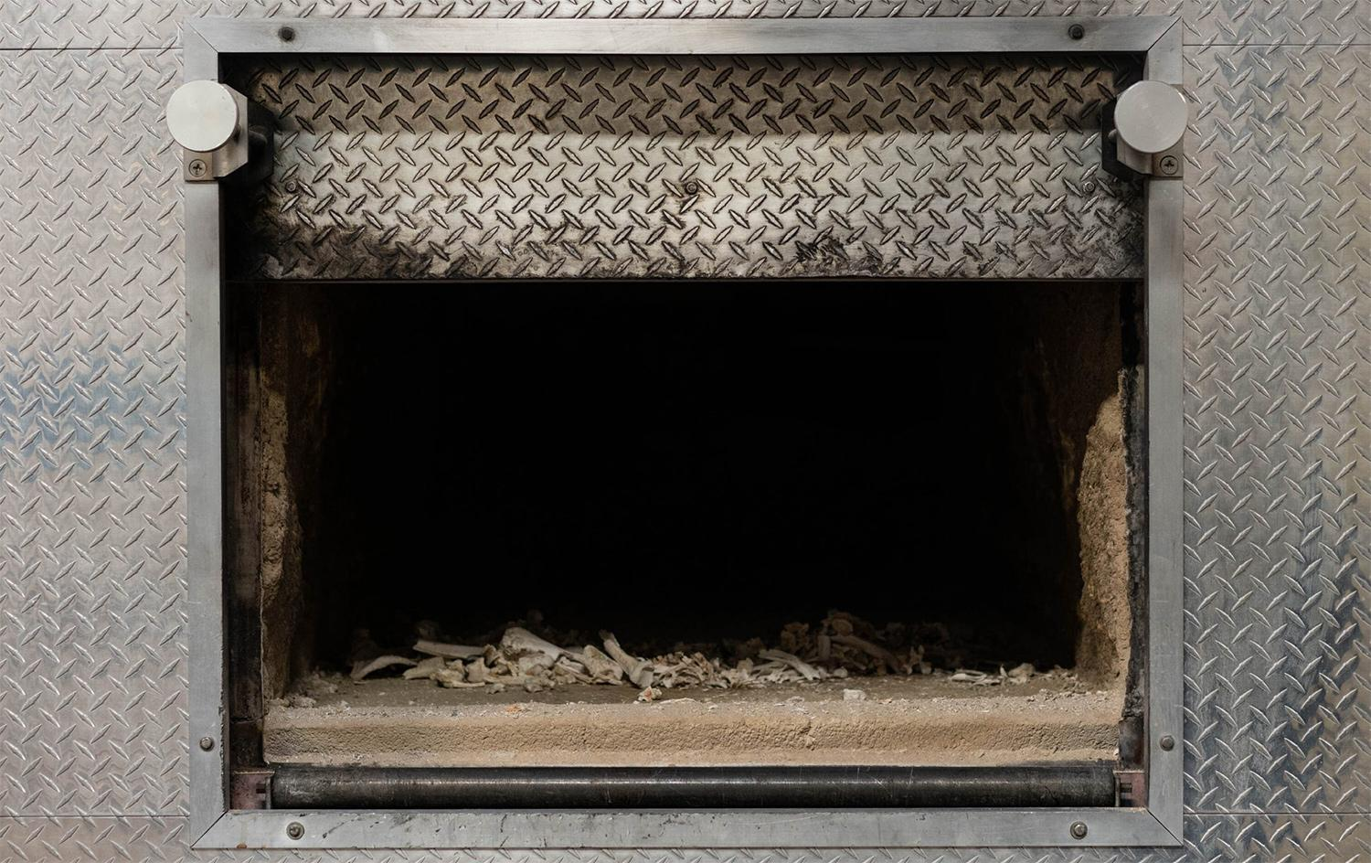 Cremated remains in crematorium incineration chamber