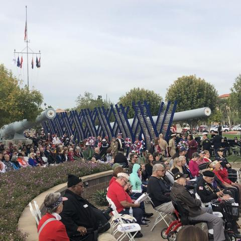 A crowd gathers under the main guns of the battleship USS Arizona to commemorate the 78th anniversary of the Pearl Harbor attacks, Dec. 7, 2019.