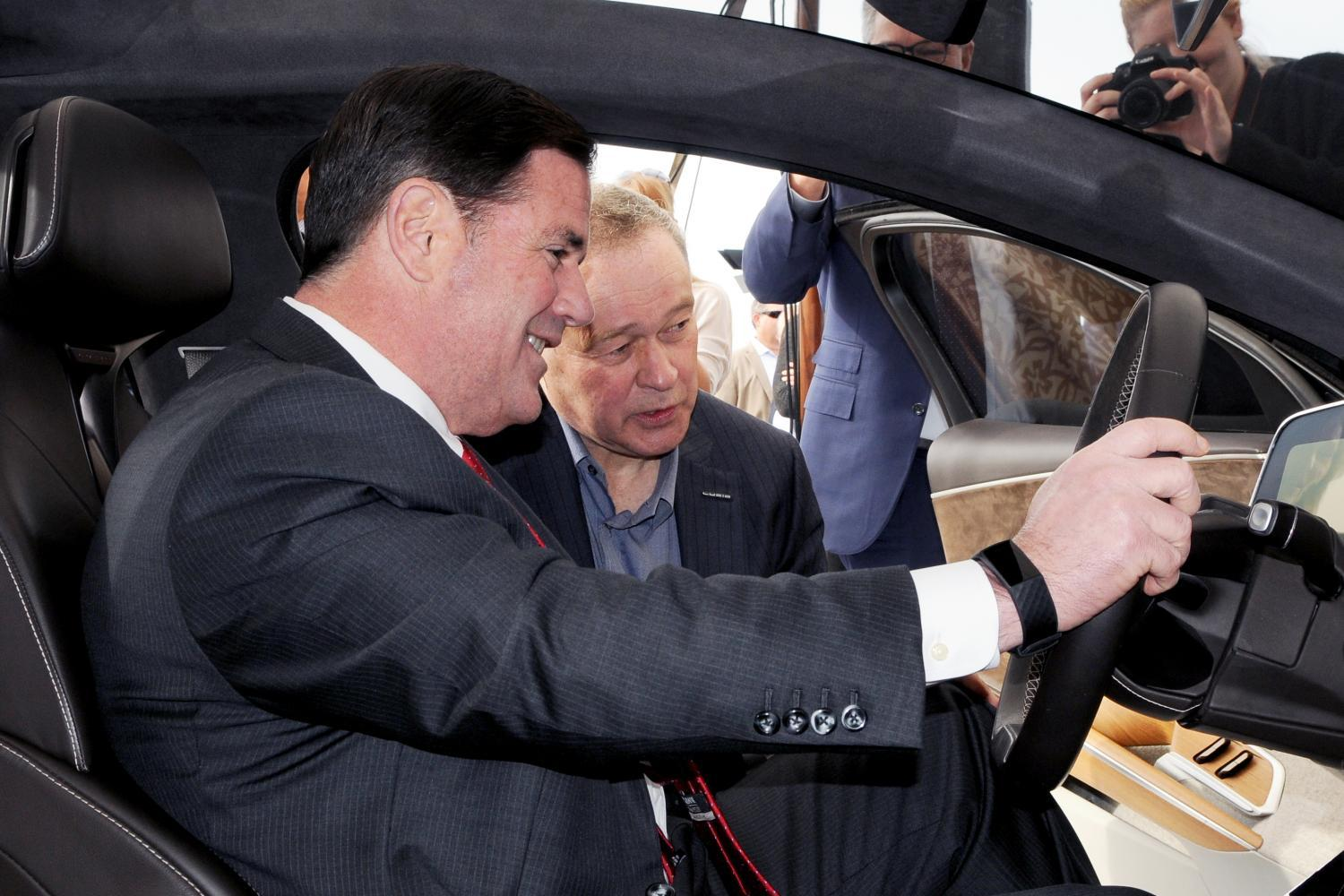 ducey in a lucid motor vehicle