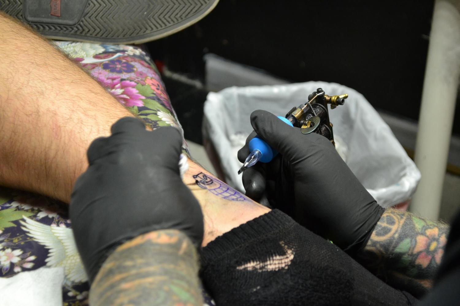 tattoo needle and ink on an ankle