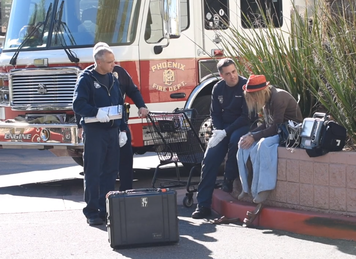 first responders help a patient