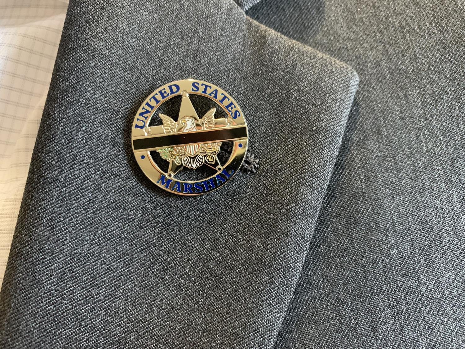 A lapel pin on an agent