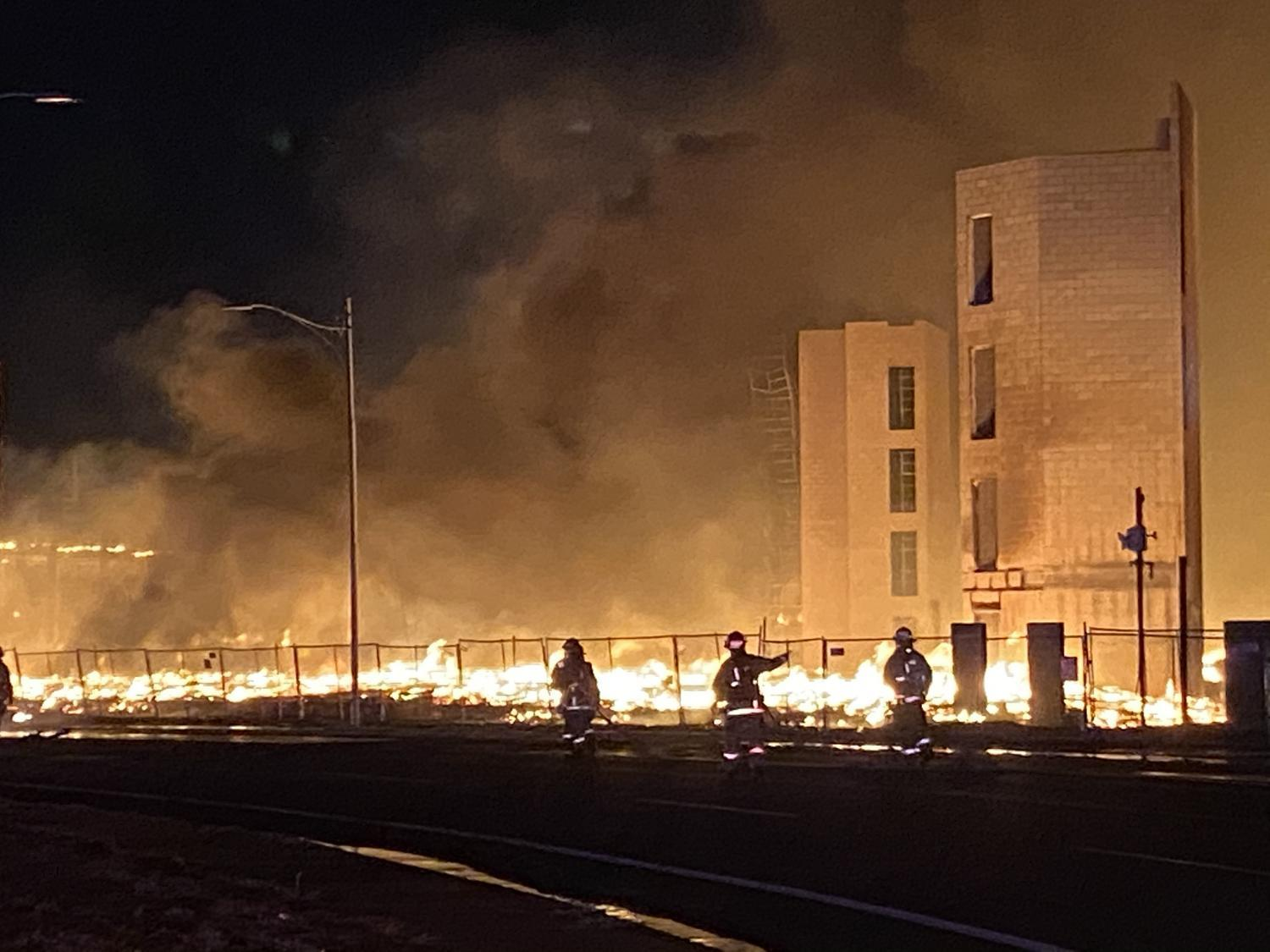 Firefighters fight a 2-alarm fire at a construction site in downtown Phoenix on Jun. 7, 2020, which investigators ruled arson.