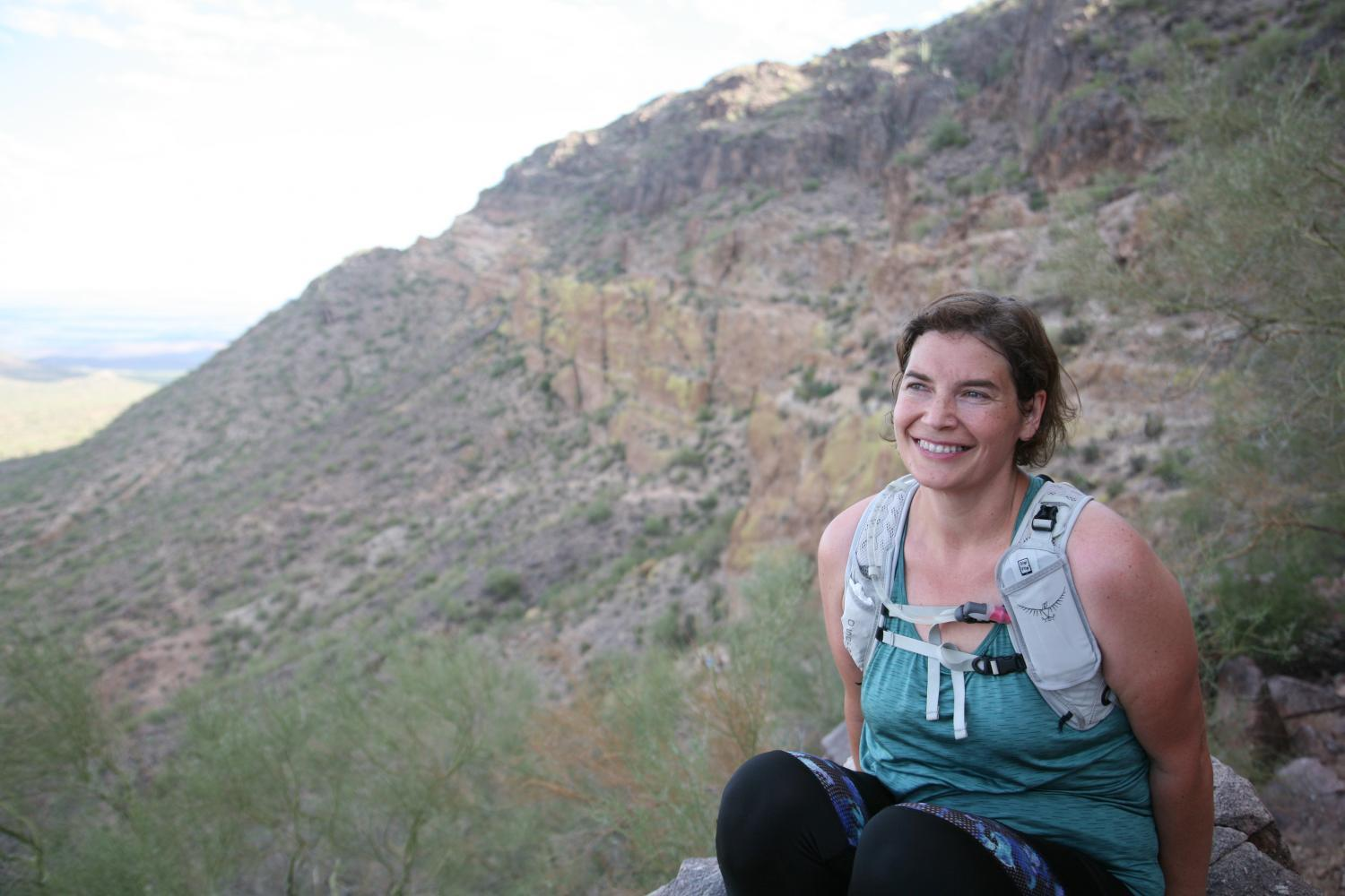megan asad smiling on a trail