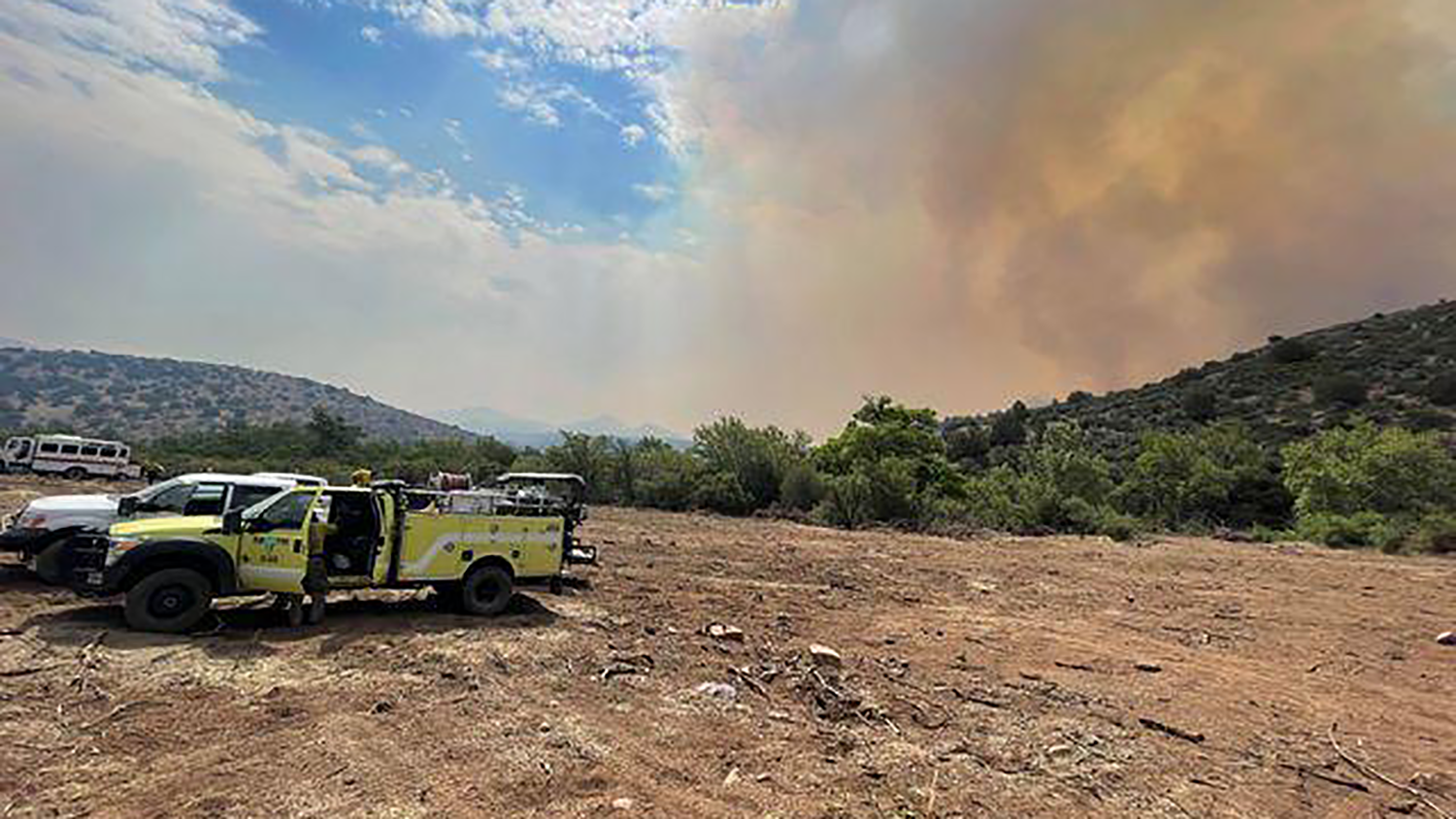 Smoke rises from the Mescal Fire
