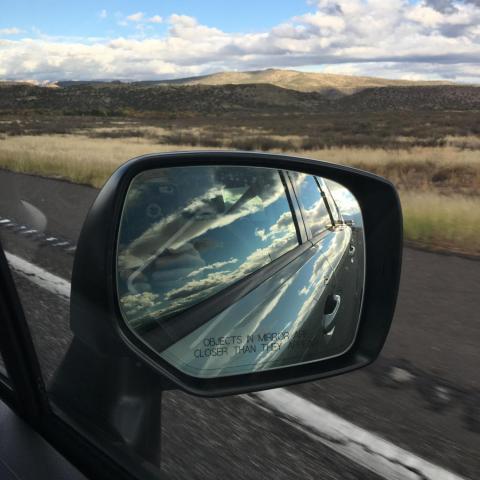 monsoon in rear view mirror