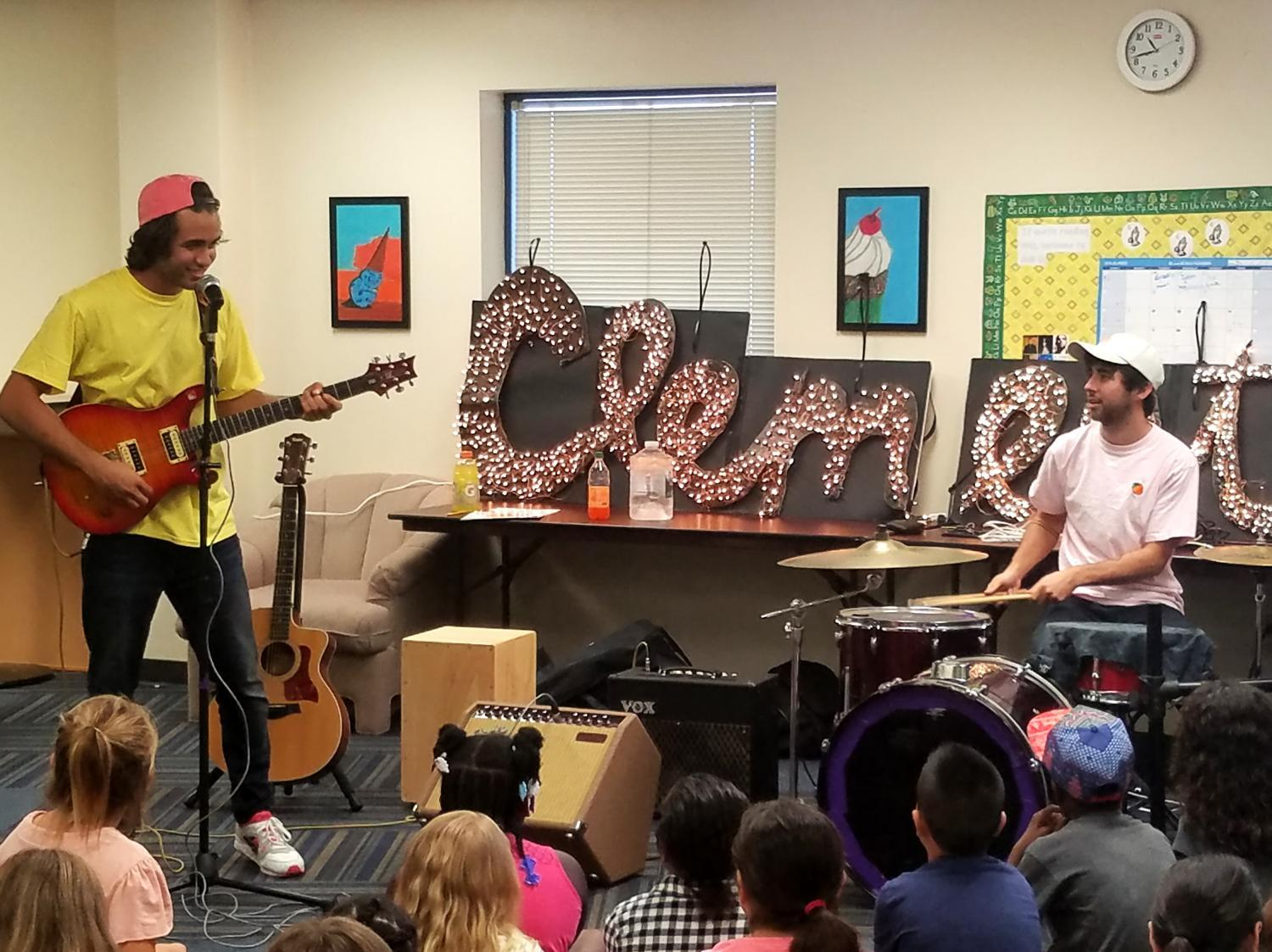 musicians showing kids how they play instruments