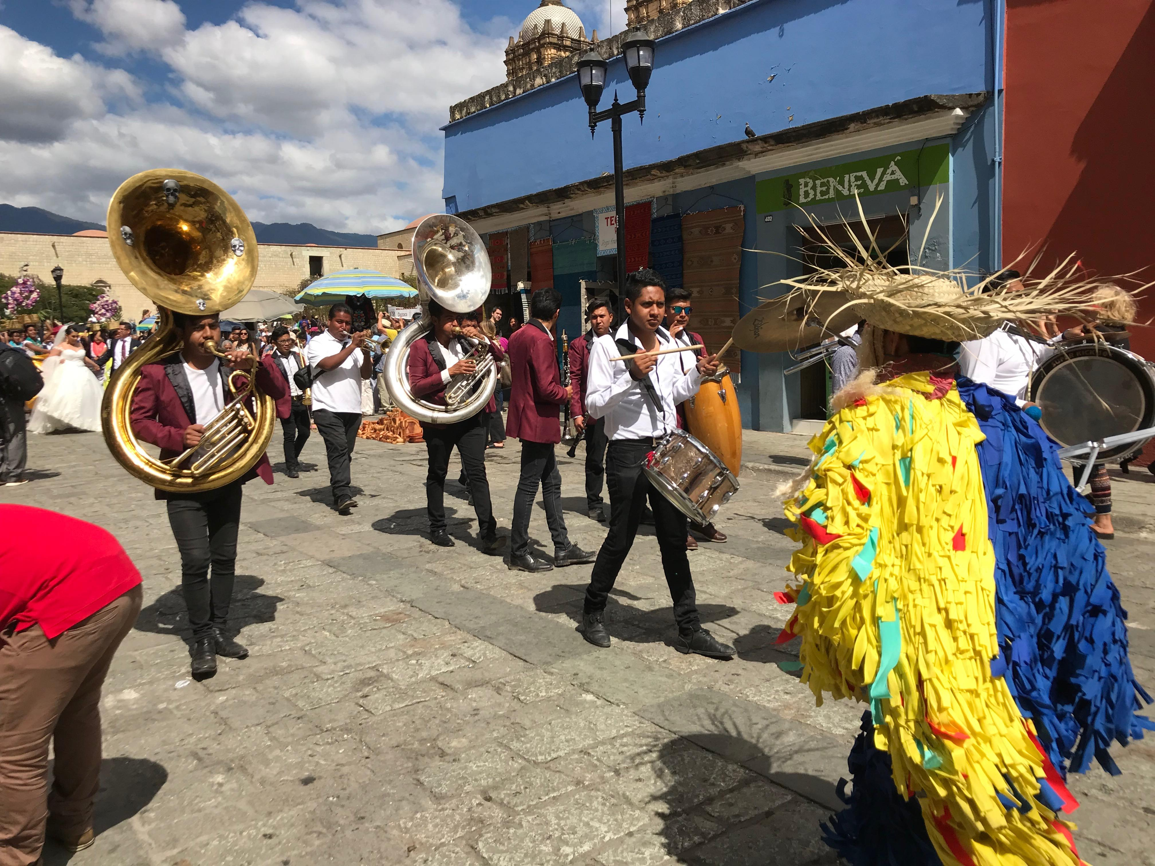 Dancers and musicians outside the Santo Domingo church near downtown Oaxaca, Mexico
