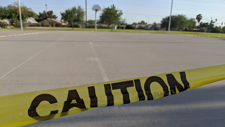 caution tape around a basketball court