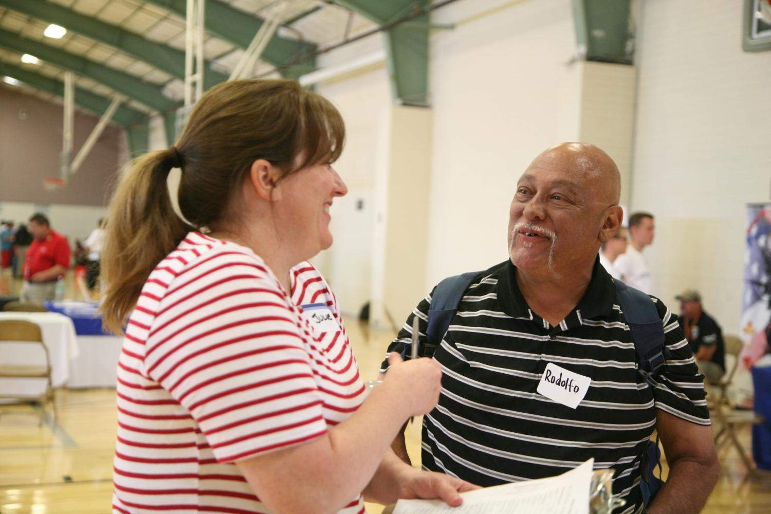 a volunteer chats with a client at project connect