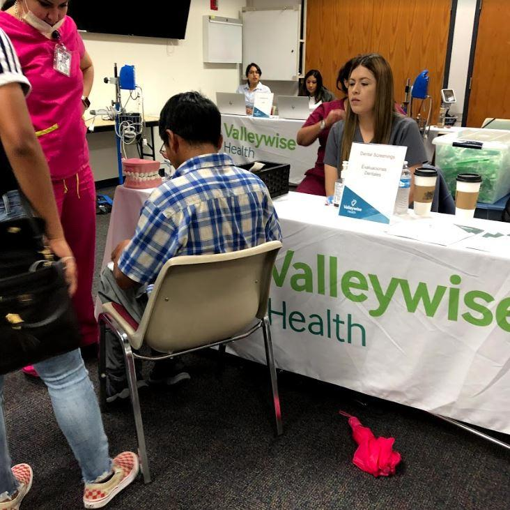 Dental screenings available to refugees at Valleywise Refugee Health Fair.