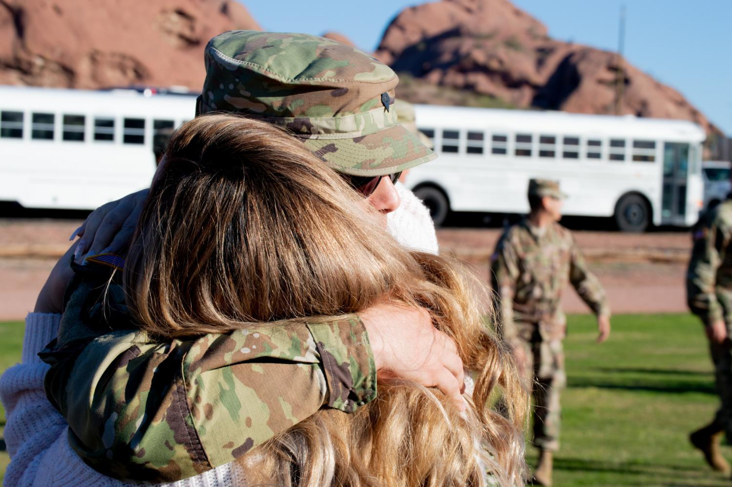 A soldier reunites with a loved one at the homecoming ceremony for the Arizona National Guard