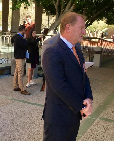 Robert Sarver standing outside council chambers