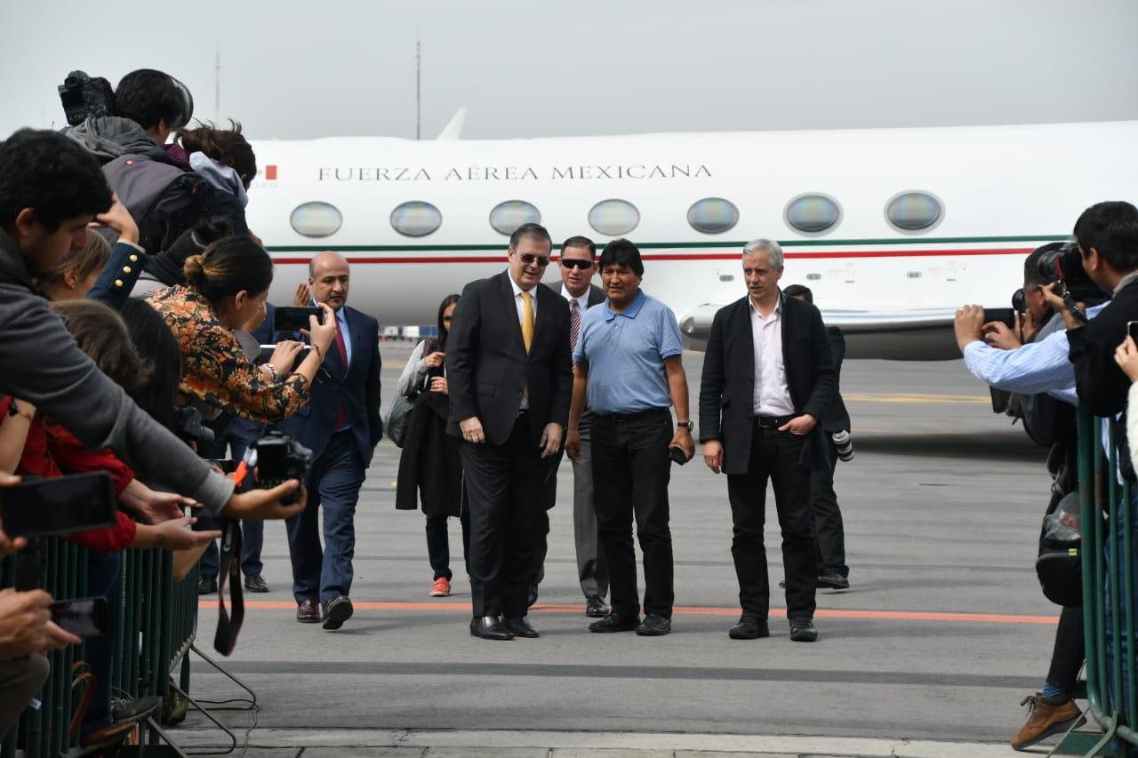 Mexican Foreign Relations Secretary Marcelo Ebrard welcomes former Bolivian President Evo Morales at the Mexico City airport on Tuesday morning.