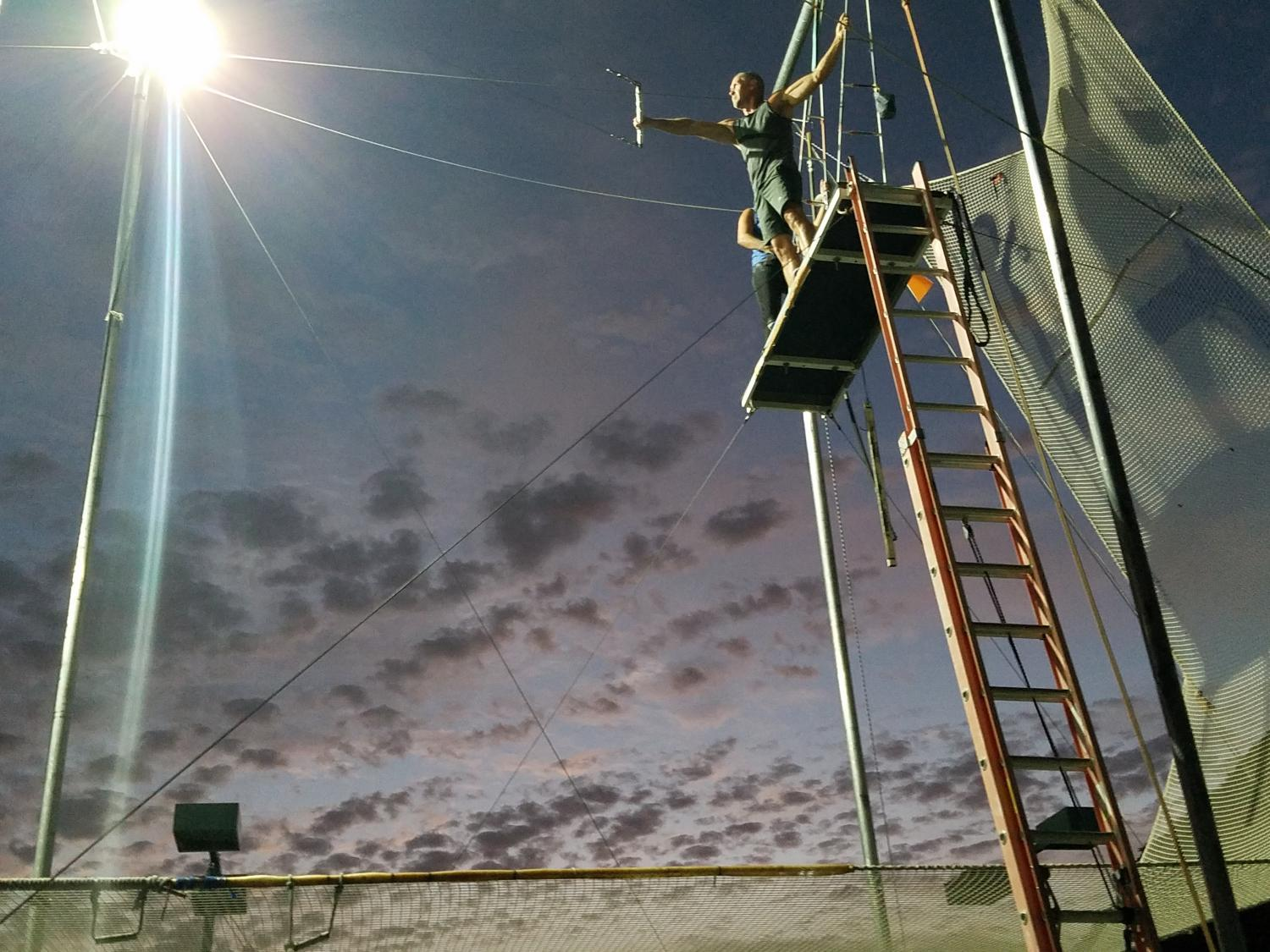 a person getting ready to trapeze