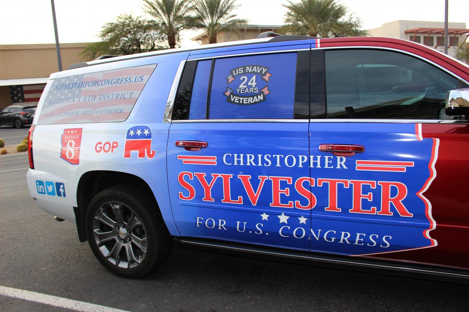 "Sylvester painted his truck with campaign art, making him a ""driving billboard."""