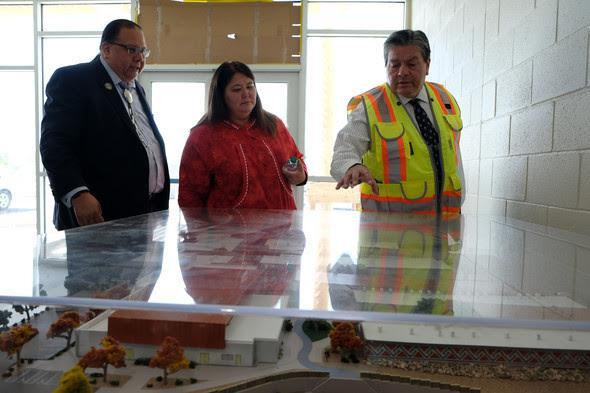 Officials tour the new school.