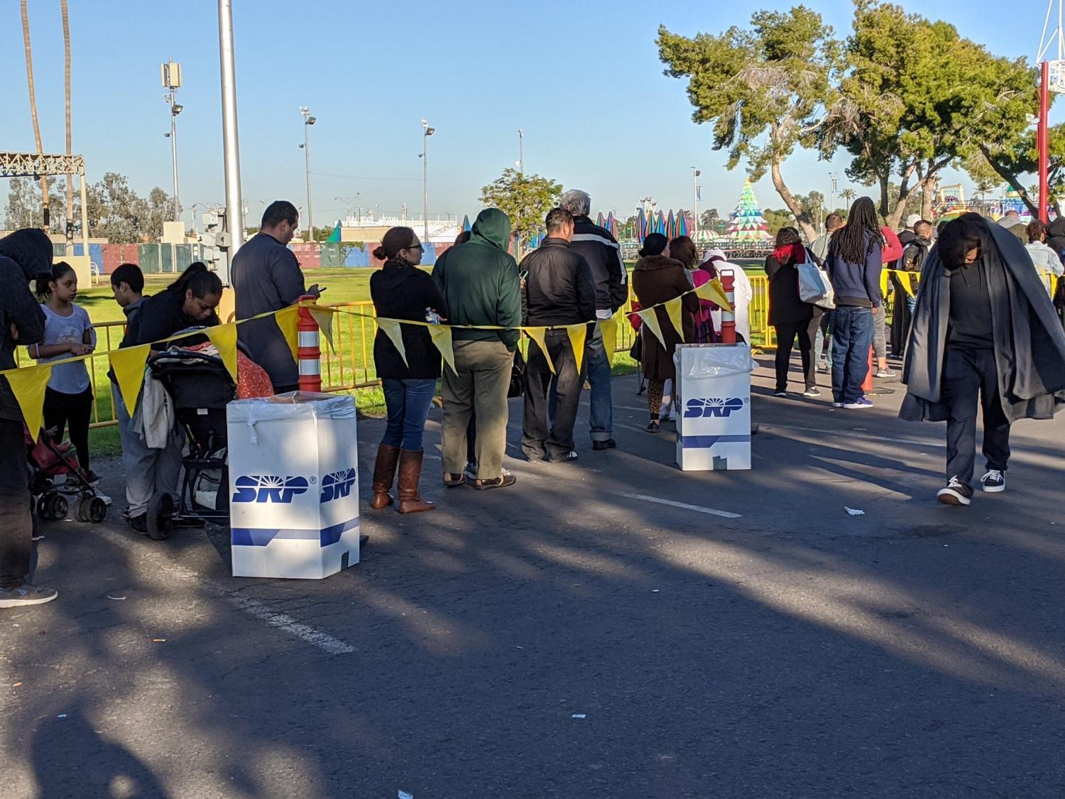 People waited in line overnight to get into Veterans Memorial Coliseum in Phoenix for a free dental work event.