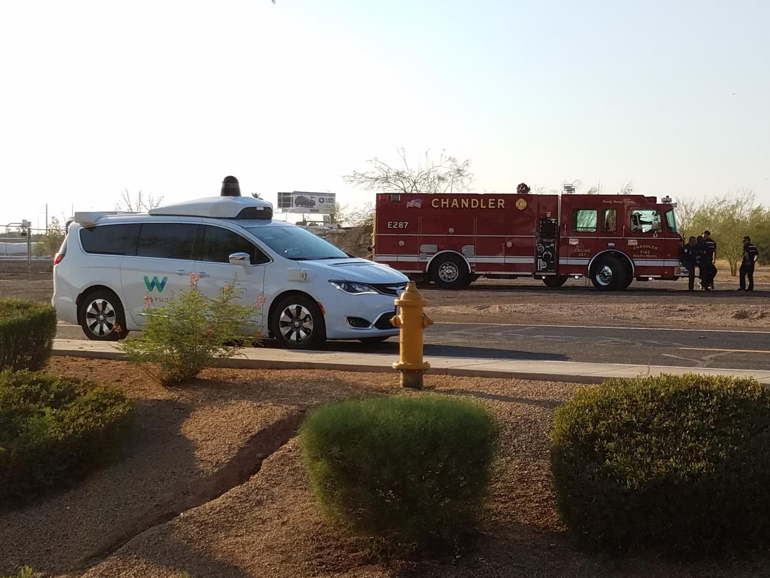 waymo car and fire truck