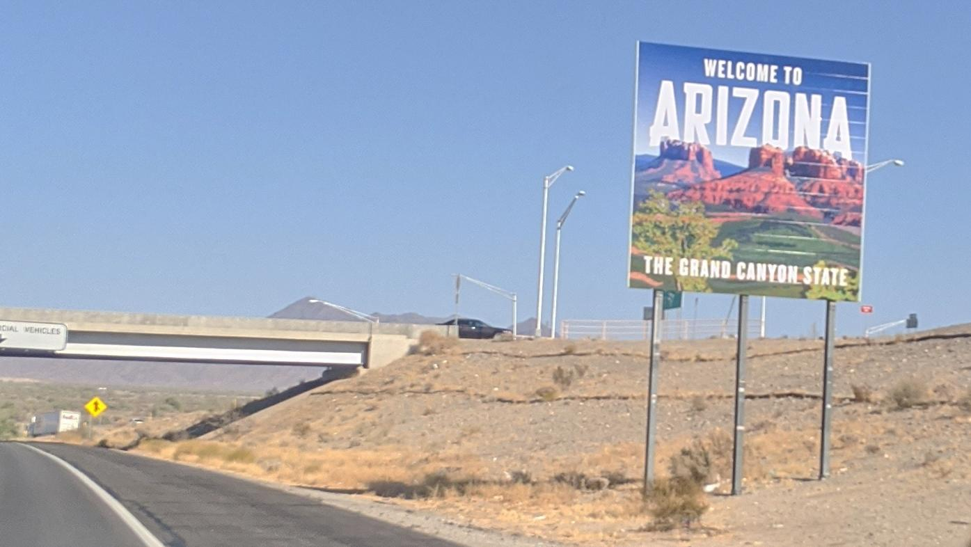 A sign welcoming visitors to Arizona