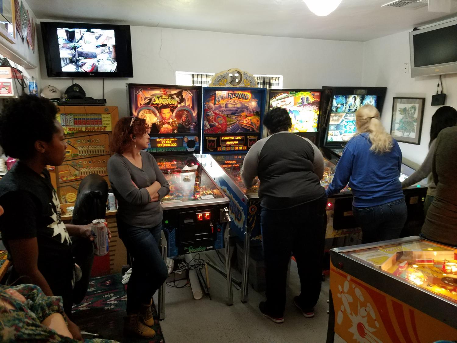 women playing pinball