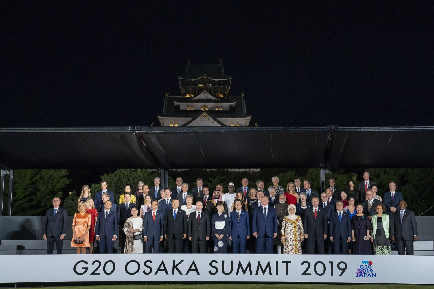 President Donald Trump participates in a group photo during G20 Cultural Program