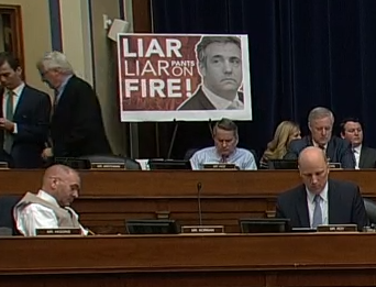 "sign that read ""Liar, Liar Pants on Fire"""