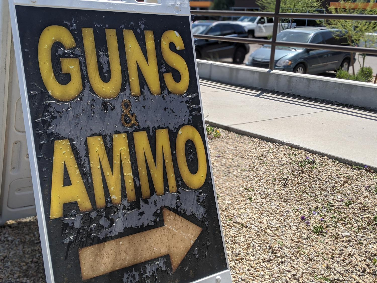 sign advertising guns and ammo
