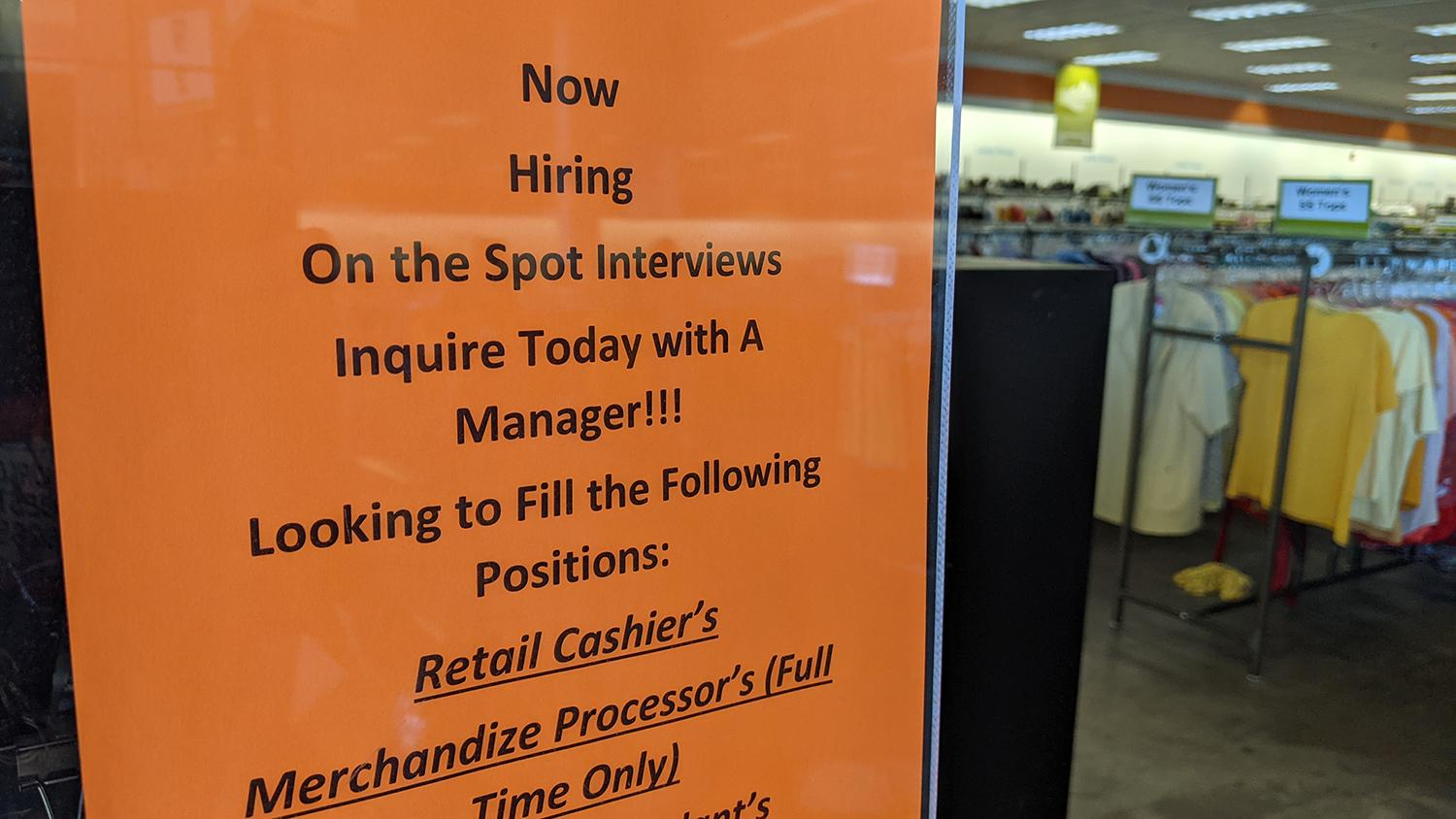 A hiring sign at a Tempe store