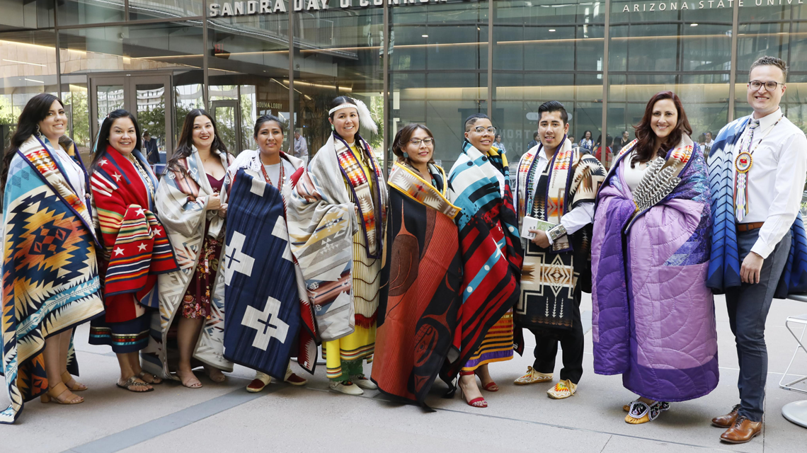 Several students pose during the blanket ceremony