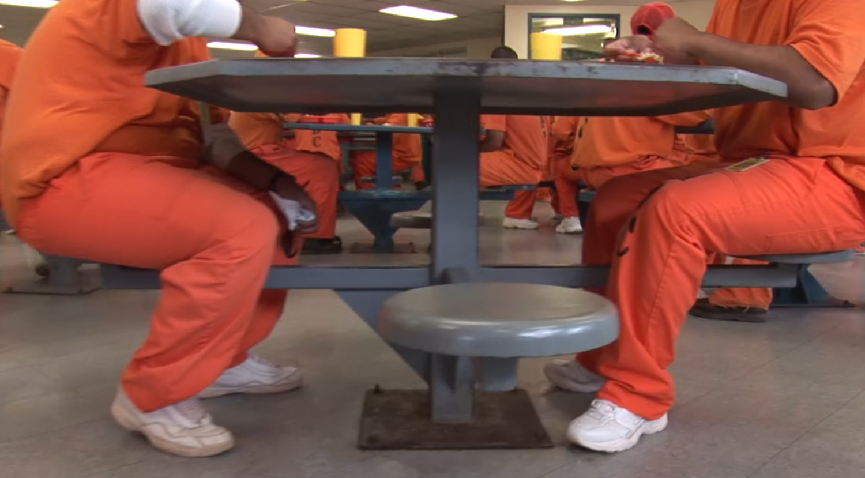 Inmates eat at an Arizona prison