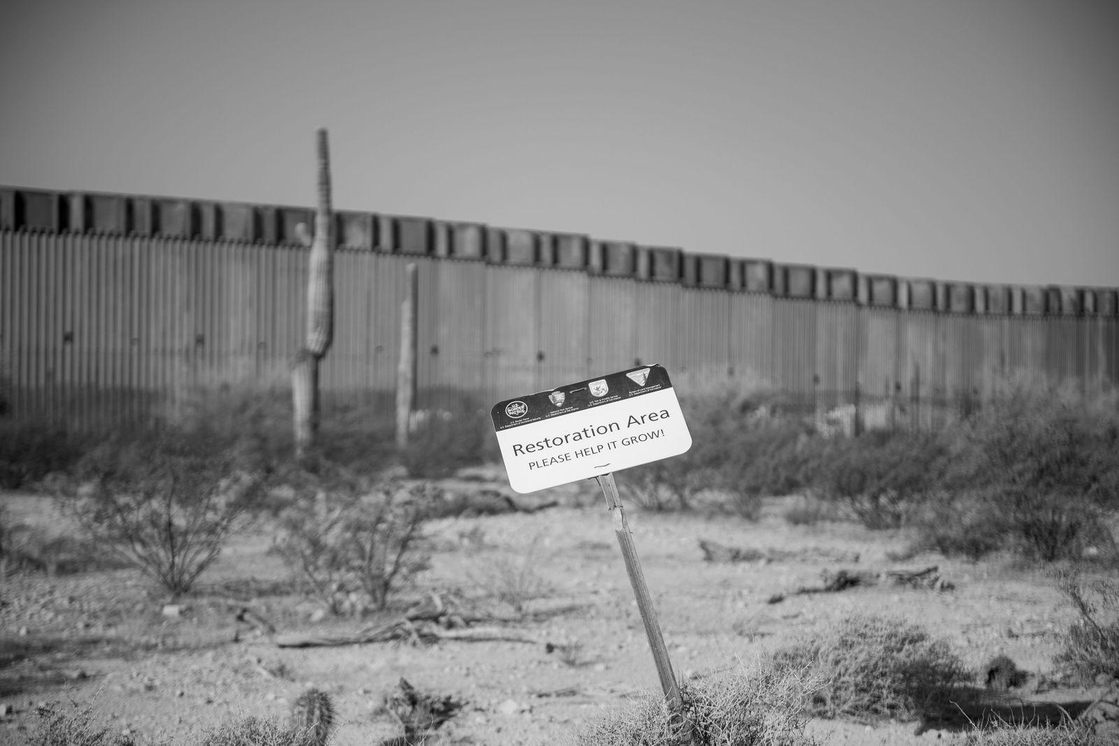 Border wall restoration area sign John Kurc