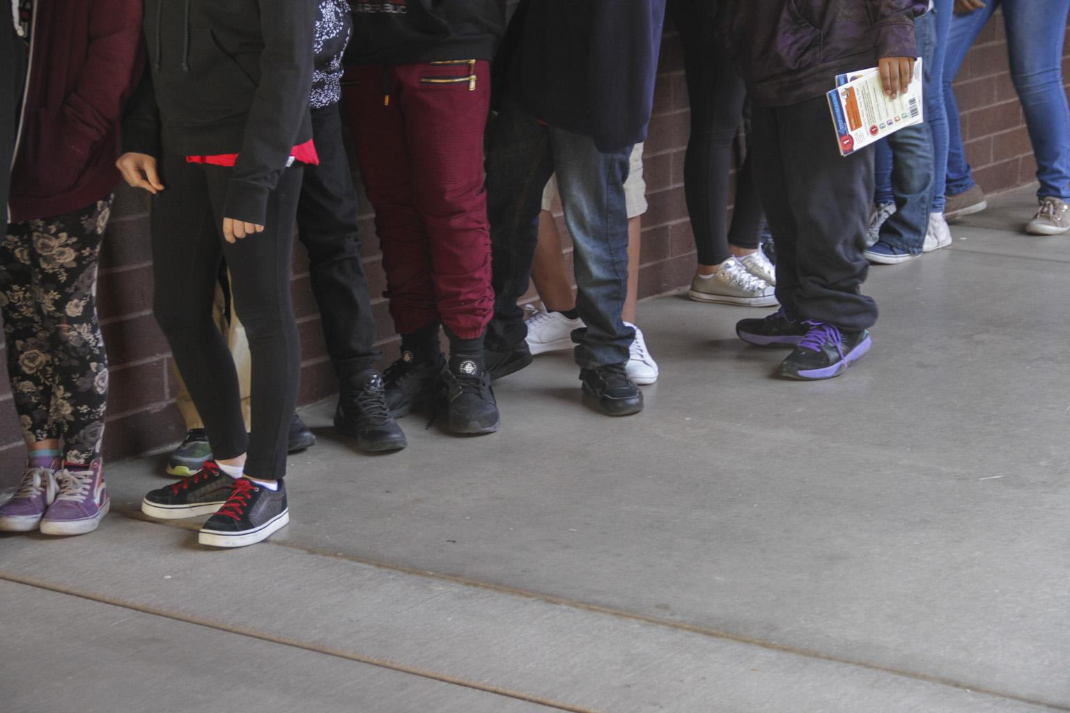 students stand in line