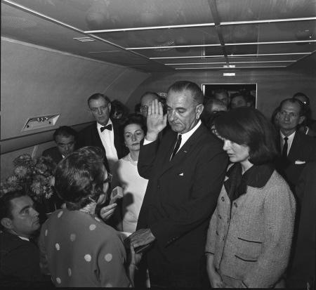 Lyndon B. Johnson swearing in as president