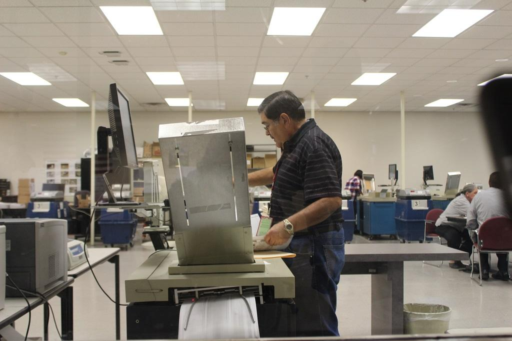 mail-in ballots put through a counting machine