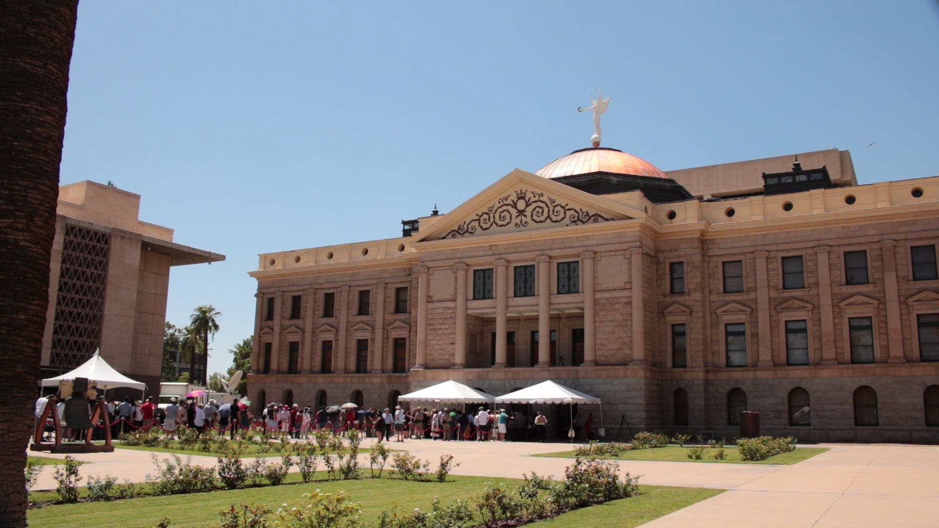 People begin to enter the Arizona Capitol