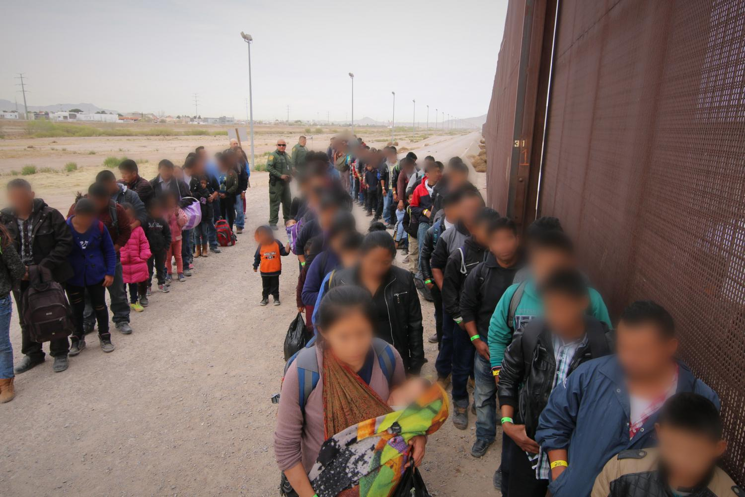 U.S. Border Patrol agents intercept a group of approximately 127 migrants