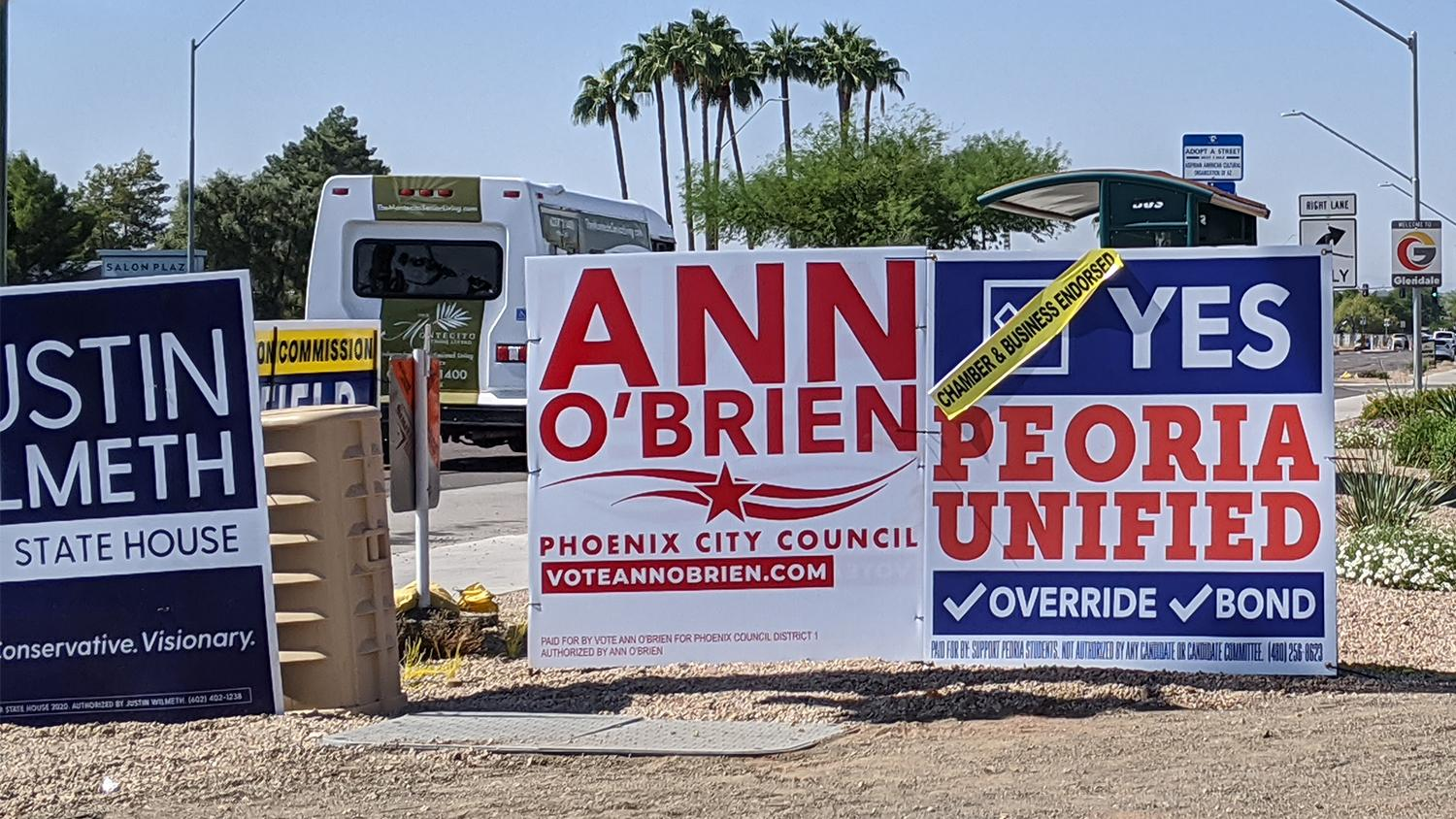 A sign for a Peoria Unified School District bond and override