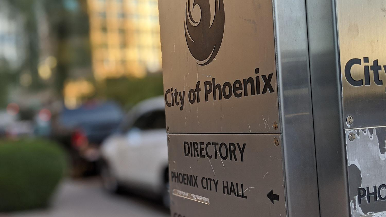 A directory in downtown Phoenix points in the direction of Phoenix City Hall