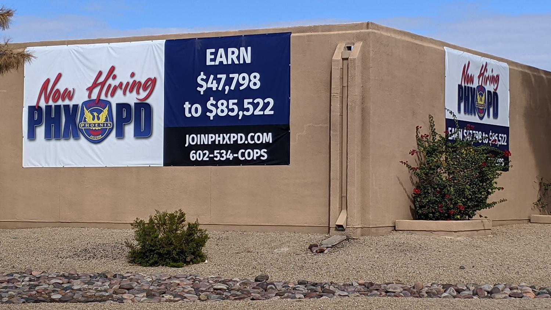 A hiring sign on a Phoenix police precinct