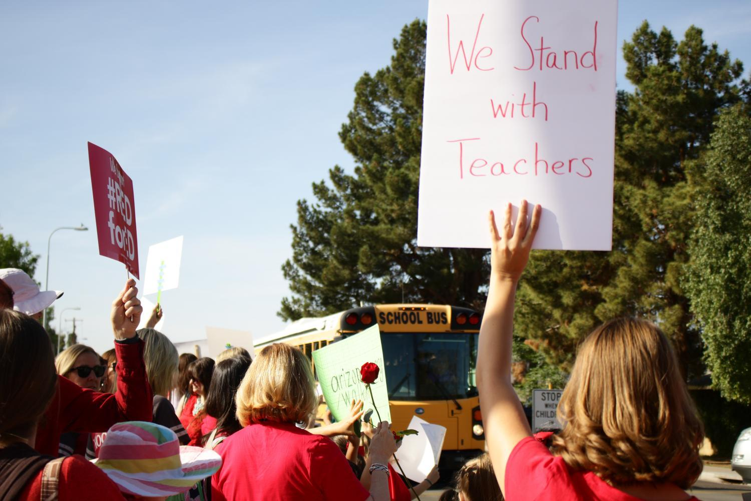 Supporters and teachers rallied outside Broadmor Elementary