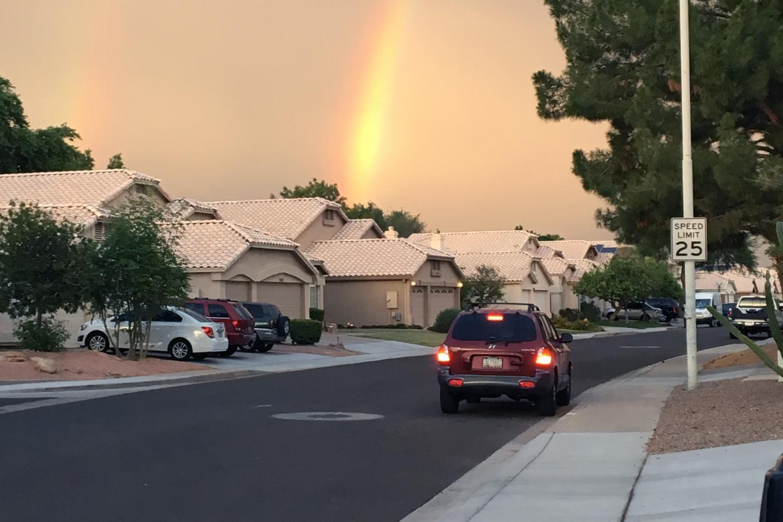 suburban houses with a rainbow