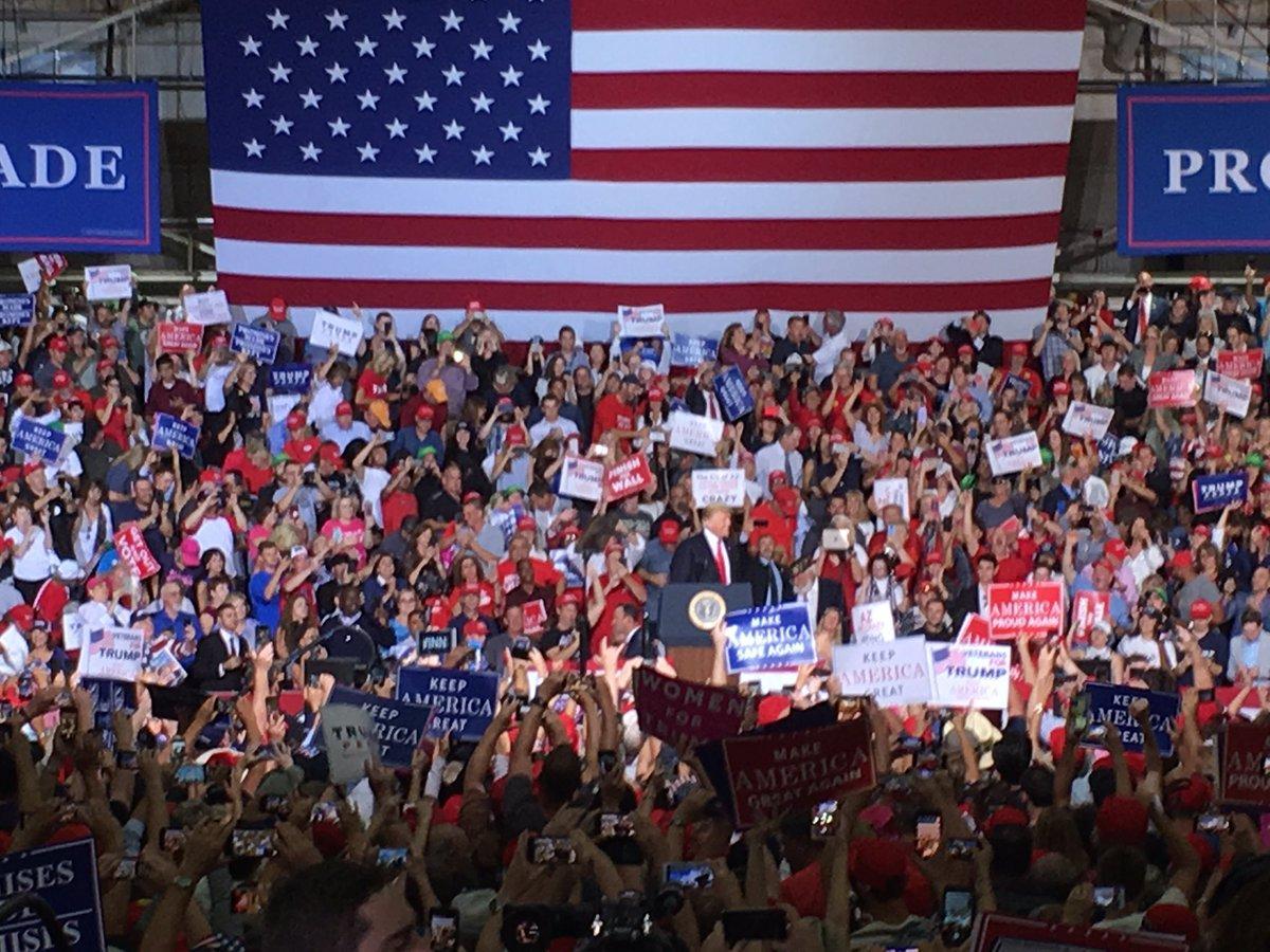 Trump at the podium at the Mesa rally — Oct. 19, 2018.