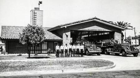 men standing in front of fire truck